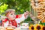 Маленькая девочка в нарядном сарафане пьет чай с бубликами, фото № 2844024, снято 25 августа 2011 г. (c) Елена Щипкова / Фотобанк Лори
