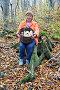 Женщина с корзинкой грибов, сидит на пеньке в лесу, фото № 4066532, снято 25 ноября 2012 г. (c) Анна Мартынова / Фотобанк Лори