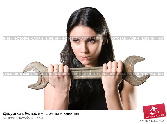 Девушка с большим гаечным ключом, фото № 1369164, снято 12 декабря 2009 г. (c) Okssi / Фотобанк Лори