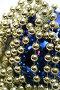 Синий стеклянный шар с узором и праздничные бусы золотистого цвета, фото № 14120, снято 20 ноября 2006 г. (c) Александр Паррус / Фотобанк Лори