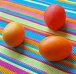Три крашеных пасхальных яйца на полосатой скатерти, фото № 19832, снято 25 января 2007 г. (c) only / Фотобанк Лори