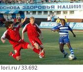 Купить «Африканский футболист рвется к воротам», фото № 33692, снято 29 июля 2005 г. (c) 1Andrey Милкин / Фотобанк Лори