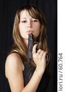 Купить «Девушка и пистолет», фото № 60764, снято 1 июля 2007 г. (c) Евгений Батраков / Фотобанк Лори