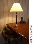 Купить «Деревянный стол и горящая настольная лампа», фото № 62972, снято 24 июня 2007 г. (c) Harry / Фотобанк Лори