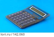 Купить «Калькулятор на голубом фоне», фото № 142060, снято 5 декабря 2007 г. (c) Валерия Потапова / Фотобанк Лори