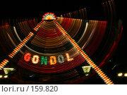 Купить «Праздничная ночная иллюминация на качели в парке аттракционов. Следы разноцветных ламп на движущейся гондоле», фото № 159820, снято 11 июня 2005 г. (c) Harry / Фотобанк Лори