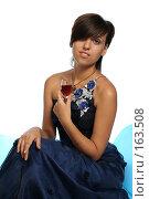 Купить «Девушка в синем выпускном платье с бокалом вина, на белом фоне», фото № 163508, снято 26 июля 2007 г. (c) Александр Паррус / Фотобанк Лори