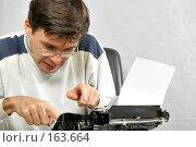 Писатель печатает бестселлер. Стоковое фото, фотограф Роман Сигаев / Фотобанк Лори