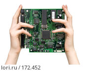 Купить «Держит компьютерную плату», фото № 172452, снято 7 февраля 2007 г. (c) chaoss / Фотобанк Лори