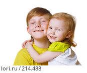Купить «Мальчик и девочка на белом фоне», фото № 214488, снято 2 марта 2008 г. (c) Майя Крученкова / Фотобанк Лори