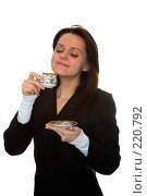 Купить «Девушка пьет чай на белом фоне», фото № 220792, снято 9 февраля 2008 г. (c) Арестов Андрей Павлович / Фотобанк Лори
