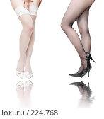 Купить «Женские ноги в черном и белом», фото № 224768, снято 27 ноября 2007 г. (c) chaoss / Фотобанк Лори