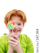 Купить «Рыжий подросток с конфетой», фото № 247964, снято 28 февраля 2008 г. (c) Ольга С. / Фотобанк Лори