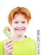 Купить «Рыжий подросток с конфетой», фото № 247968, снято 28 февраля 2008 г. (c) Ольга С. / Фотобанк Лори