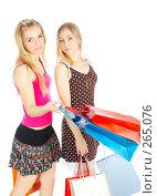 Купить «Две девушки с покупками», фото № 265076, снято 6 марта 2008 г. (c) Андрей Армягов / Фотобанк Лори