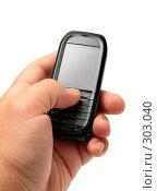 Купить «Мобильный телефон в руке», фото № 303040, снято 28 мая 2008 г. (c) Михаил Коханчиков / Фотобанк Лори