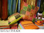 Купить «Яркие подушки на фоне портьер», фото № 314424, снято 13 марта 2008 г. (c) Gagara / Фотобанк Лори