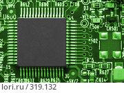 Купить «Компьютерный чип на печатной плате. Электроника.», фото № 319132, снято 18 декабря 2007 г. (c) Александр Паррус / Фотобанк Лори