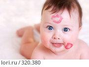 Купить «Малыш со следами поцелуев на лице», фото № 320380, снято 27 марта 2007 г. (c) Алена Роот / Фотобанк Лори