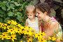Мать с дочерью смотрят на цветы, фото № 340604, снято 27 июля 2017 г. (c) Losevsky Pavel / Фотобанк Лори