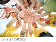 Купить «Семь друзей сложили руки друг на дружку», фото № 350528, снято 16 апреля 2019 г. (c) Losevsky Pavel / Фотобанк Лори