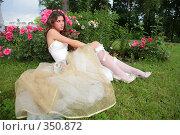 Купить «Девушка в саду», фото № 350872, снято 3 июля 2008 г. (c) Astroid / Фотобанк Лори