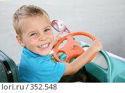 Купить «Мальчик за рулем игрушечной машины», фото № 352548, снято 19 июля 2018 г. (c) Losevsky Pavel / Фотобанк Лори