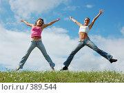 Купить «Девушки прыгают на поляне», фото № 389544, снято 26 июля 2007 г. (c) Юрий Коновал / Фотобанк Лори
