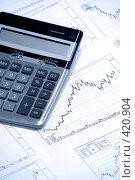 Купить «Калькулятор и графики, на которых изображен бычий график», фото № 420904, снято 27 февраля 2006 г. (c) Роман Бородаев / Фотобанк Лори