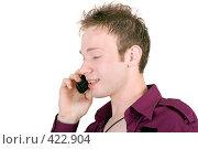 Купить «Молодой мужчина говорит по телефону. На белом фоне изолированно», фото № 422904, снято 6 июля 2008 г. (c) Сергей Сухоруков / Фотобанк Лори