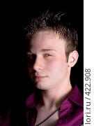 Купить «Портрет молодого мужчины на черном фоне  изолированно», фото № 422908, снято 6 июля 2008 г. (c) Сергей Сухоруков / Фотобанк Лори