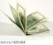 Купить «Купюры долларов США сложенные пополам», фото № 429064, снято 16 апреля 2008 г. (c) Кирилл Курашов / Фотобанк Лори