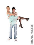 Купить «Молодой человек держит девушку на руках», фото № 465656, снято 26 марта 2019 г. (c) Losevsky Pavel / Фотобанк Лори