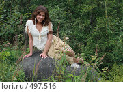 Женщина сидит на камне. Стоковое фото, фотограф Сергей Халадад / Фотобанк Лори