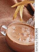 Купить «Большая чашка кофе на скатерти с вазой», фото № 504964, снято 4 октября 2008 г. (c) Марина Дмитриевых / Фотобанк Лори
