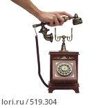 Купить «Старинный телефон в деревянном корпусе. Кладут трубку», фото № 519304, снято 21 октября 2008 г. (c) Лошкарев Антон / Фотобанк Лори