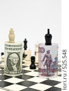 Купить «Противостояние курсов доллара и рубля выраженное через шахматную партию», фото № 525548, снято 26 октября 2008 г. (c) Кузнецов Дмитрий / Фотобанк Лори