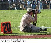 Купить «Спортивный фотограф», фото № 530348, снято 14 октября 2006 г. (c) Yevgeniy Zateychuk / Фотобанк Лори