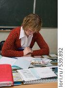 Купить «Учительница проверяет тетради», эксклюзивное фото № 539892, снято 1 ноября 2008 г. (c) Ирина Солошенко / Фотобанк Лори