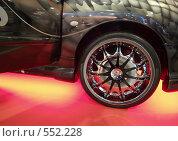 Купить «Колесо спортивного автомобиля с яркой подсветкой», фото № 552228, снято 1 ноября 2008 г. (c) Александр Кузовлев / Фотобанк Лори