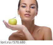 Купить «Девушка с яблоком», фото № 570680, снято 6 сентября 2008 г. (c) Serg Zastavkin / Фотобанк Лори