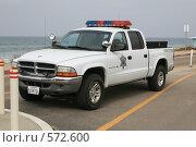 Купить «Машина шерифа на берегу океана», фото № 572600, снято 19 октября 2008 г. (c) Блинова Ольга / Фотобанк Лори
