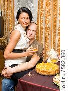 Купить «Молодая пара за новогодним столом», фото № 582360, снято 9 октября 2008 г. (c) Ольга Красавина / Фотобанк Лори