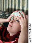 Купить «Девушка лечит мигрень компрессом», фото № 586512, снято 21 ноября 2008 г. (c) Яков Филимонов / Фотобанк Лори