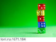 Купить «Разноцветные кости на зеленом сукне», фото № 671184, снято 21 января 2009 г. (c) Андрей Армягов / Фотобанк Лори