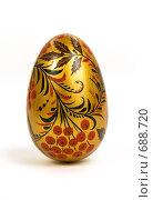 Золотое пасхальное яйцо на белом фоне. Стоковое фото, фотограф Юрий Пономарёв / Фотобанк Лори