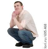 Портрет юноши сидящего на корточках. Стоковое фото, фотограф pzAxe / Фотобанк Лори