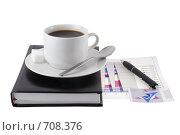 Купить «Закрытый ежедневник,чашка кофе и экономические  цветные  графики под ним», фото № 708376, снято 11 января 2009 г. (c) Vitas / Фотобанк Лори