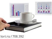 Купить «Бизнес-ежедневник,чашка кофе и экономические  цветные графики на заднем фоне», фото № 708392, снято 11 января 2009 г. (c) Vitas / Фотобанк Лори