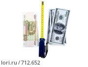 Купить «Рубли, доллары и измерительная рулетка», фото № 712652, снято 19 января 2009 г. (c) Vitas / Фотобанк Лори